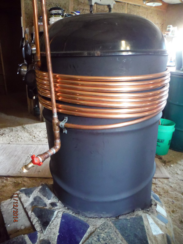 Rocket stove barrel copper hot water heating coils