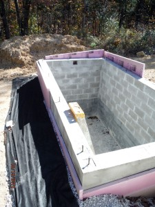 cistern backfilled with insulation, gravel, and drain tile