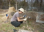 John making cedar stakes to build log retaining walls