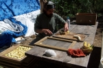 Tony chopping up bananas for the solar food dehydrator