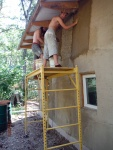 Manu and Daniel plastering on the duplex