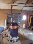 Rocket stove with hot water coils