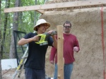 John cuts porch post notches while Jesse watches